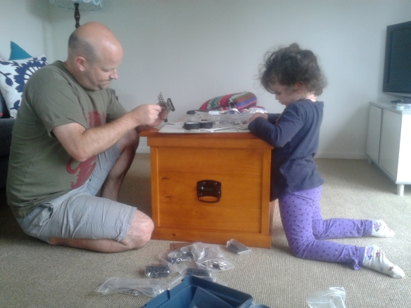 Miss Almost 4 and I using a Robotics Kit (bought from The Mind Lab) trying to make a car faster than Lightning McQueen